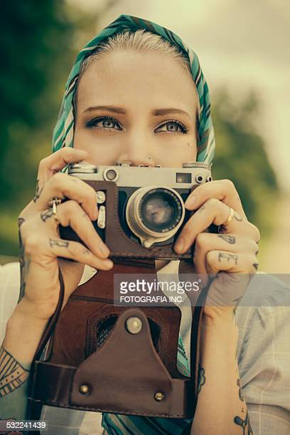 Young woman with the vintage camera
