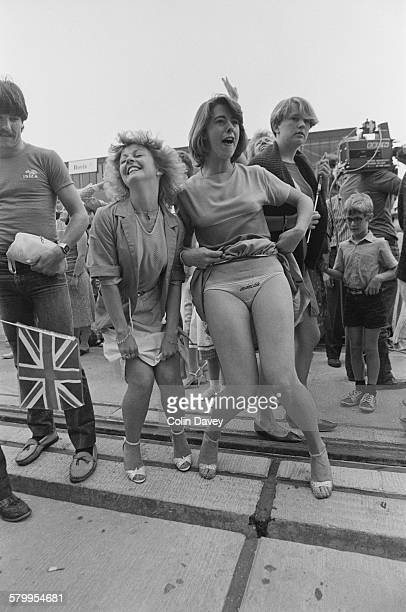 A young woman with the word 'Invincible' embroidered on her knickers welcomes the HMS Invincible back from the Falklands during the Falklands War...