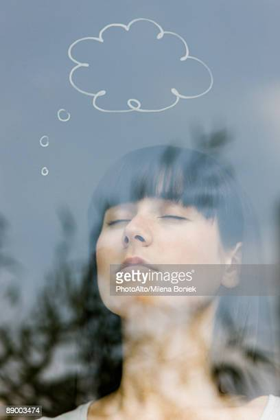 Young woman with thought bubble over head