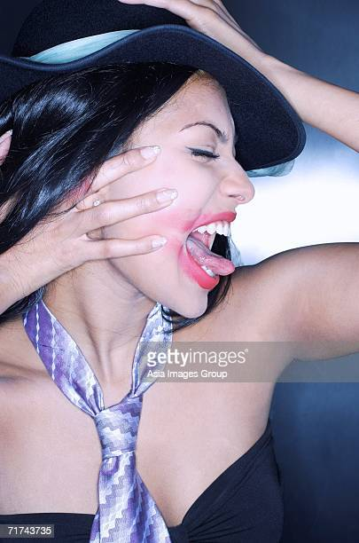 young woman, with tongue out, lipstick smeared, side view - ugly asian woman stock photos and pictures