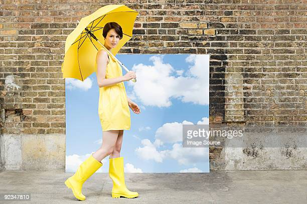 young woman with umbrella and sky background - white boot stock pictures, royalty-free photos & images