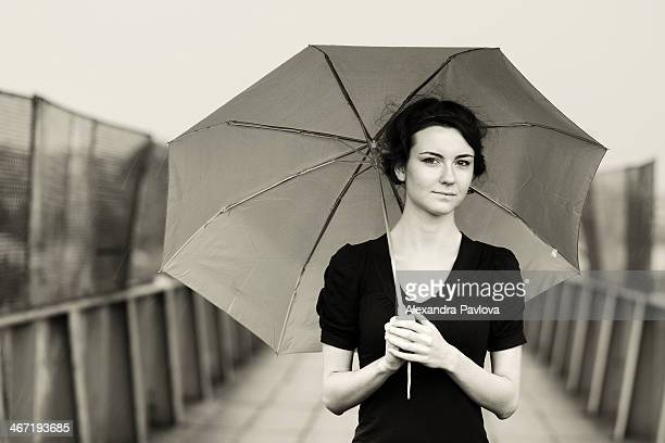 young woman with umbrella in black and white - alexandra pavlova stock pictures, royalty-free photos & images