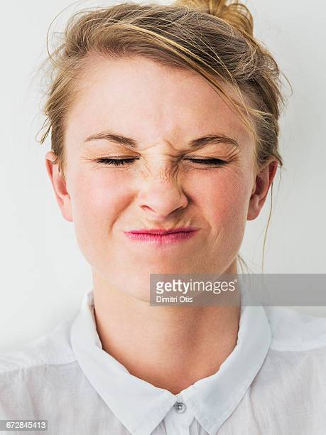 Young woman with uncomfortable expression