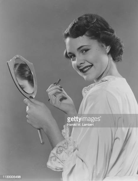 young woman with vanity mirror