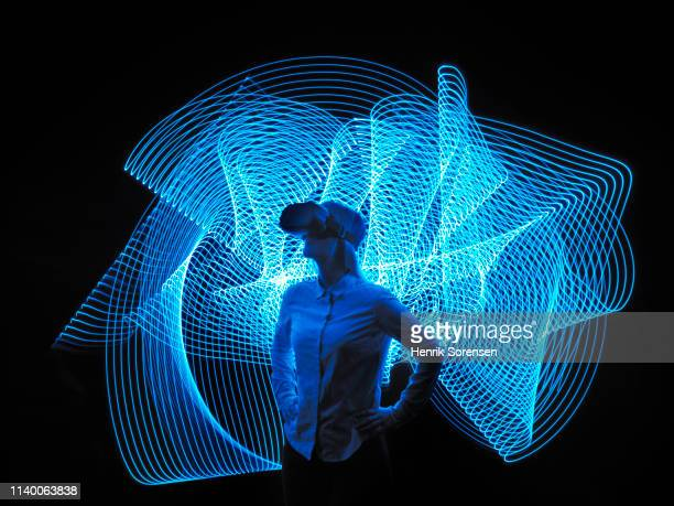 young woman with vr glasses - futuristisch stockfoto's en -beelden