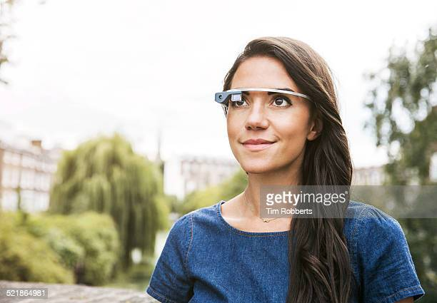 Young woman with wearing smart glass.