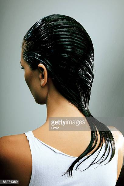 young woman with wet hair combed over shoulder
