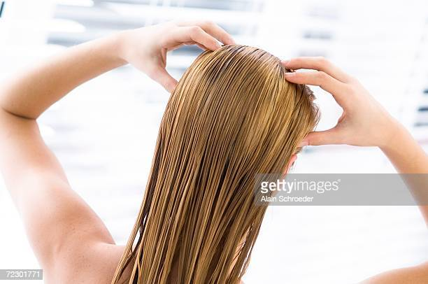 young woman with wet hair, view from the back, close up (studio) - body care and beauty stock pictures, royalty-free photos & images