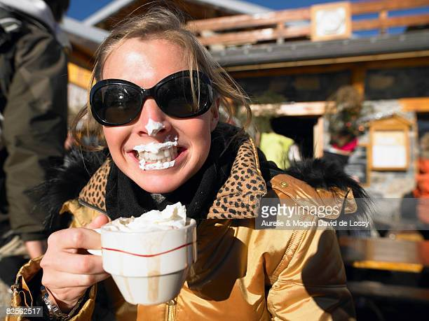 Young woman with whipped cream on lips