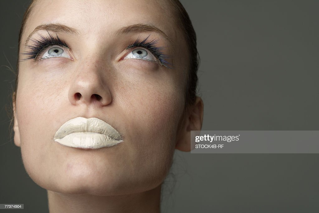 Young woman with white colored lips (part of), close-up : Photo