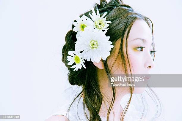 Young woman with white flowers in head