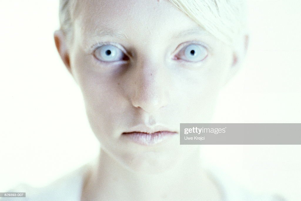 young woman with white hair and pale blue eyes closeup ストック