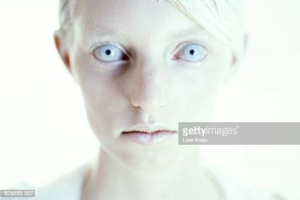 Young woman with white hair and pale blue eyes, close-up