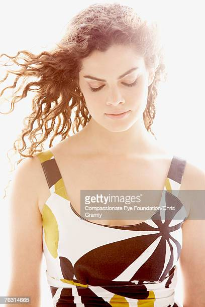 young woman with windswept hair against white background, upper half - cef stock pictures, royalty-free photos & images