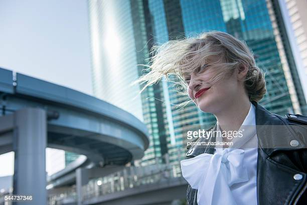 young woman with windswept hair. - blouse stockfoto's en -beelden