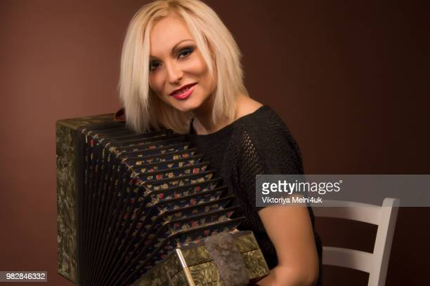 young woman with with an accordion - accordionist stock pictures, royalty-free photos & images