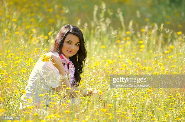 Young woman with yellow daisy.
