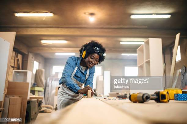 young woman working as a carpenter - eye protection stock pictures, royalty-free photos & images