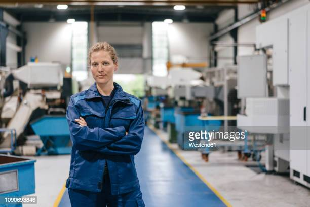 young woman working as a skilled worker in a high tech company, portrait - gleichheit stock-fotos und bilder