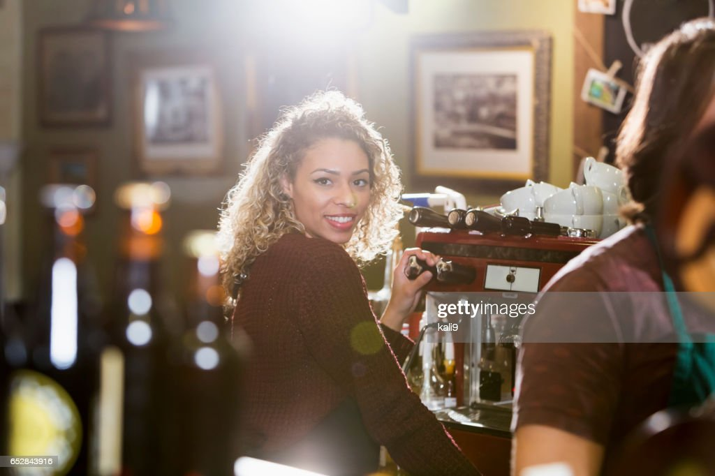 Young woman working as barista at coffee shop : Stock Photo