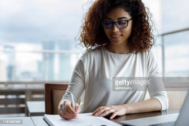 young woman working at a cafe - damircudic stock photos and pictures