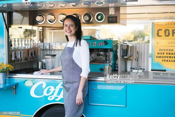 Young woman working at a food truck