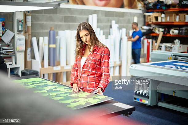 young woman working at a signage company