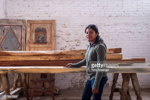 Young woman working at artisanal furniture workshop