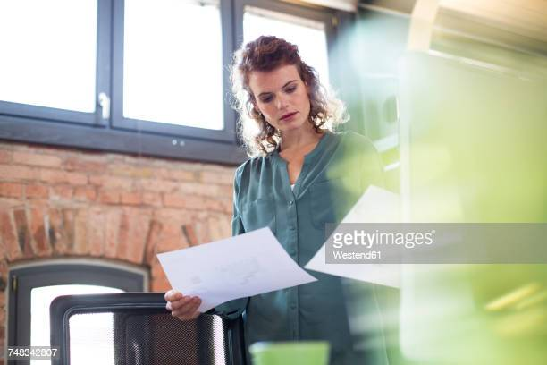 Young woman working at desk in modern office