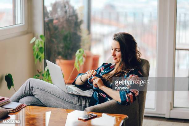 Young woman working at home at the laptop