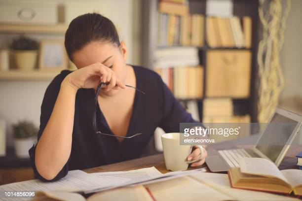 young woman working at home( headache) - illness stock pictures, royalty-free photos & images