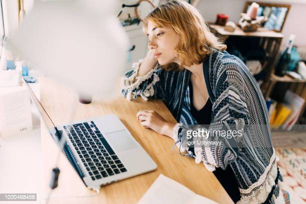 young woman working at home - jet lag stock pictures, royalty-free photos & images