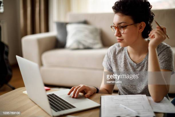 young woman working at home - diagramma di flusso foto e immagini stock