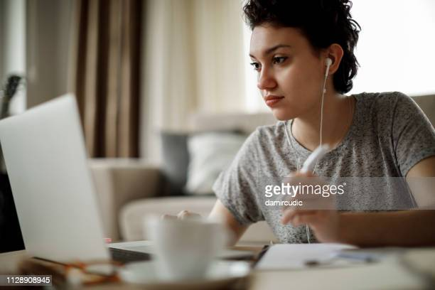 young woman working at home - distance learning stock pictures, royalty-free photos & images
