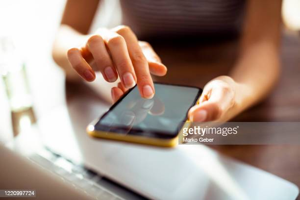 young woman working at home - mobile app stock pictures, royalty-free photos & images