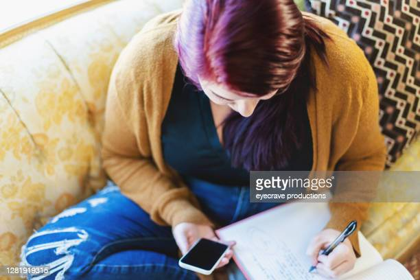 young woman working at home with technology photo series - eyecrave  stock pictures, royalty-free photos & images