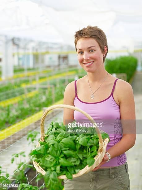 young woman working at organic farm - コロラド州 ニューキャッスル ストックフォトと画像