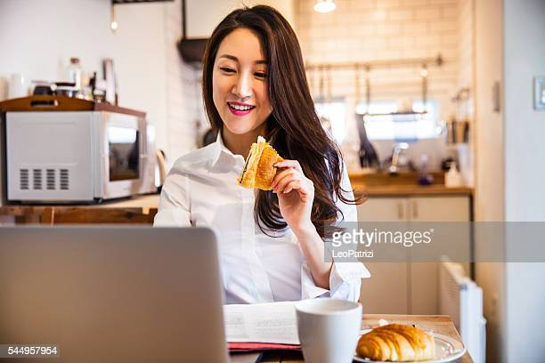 Young woman working from home in the morning