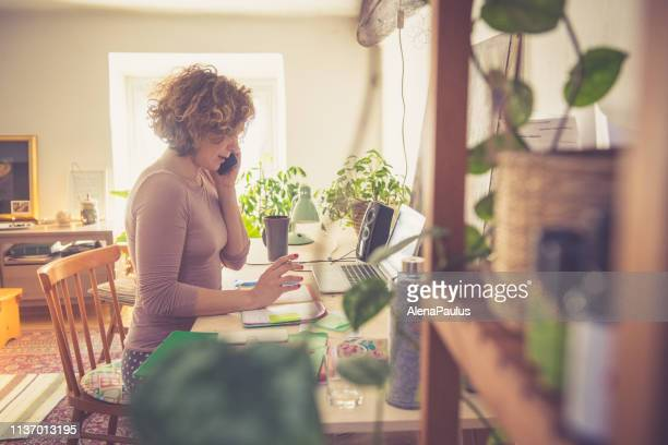 young woman working from home - home office stock pictures, royalty-free photos & images