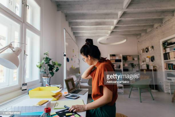 young woman working in a modern office - creativity stock pictures, royalty-free photos & images