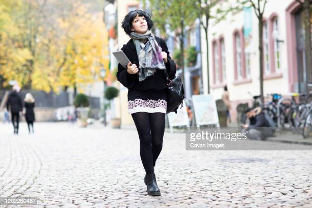 young woman working in an old city and walking - black women wearing pantyhose stock pictures, royalty-free photos & images