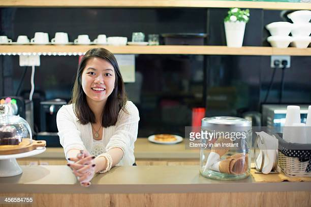 Young woman working in cafe.