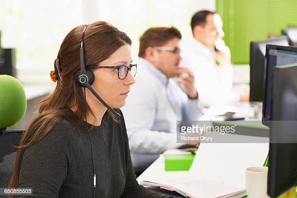 Young woman working in call centre