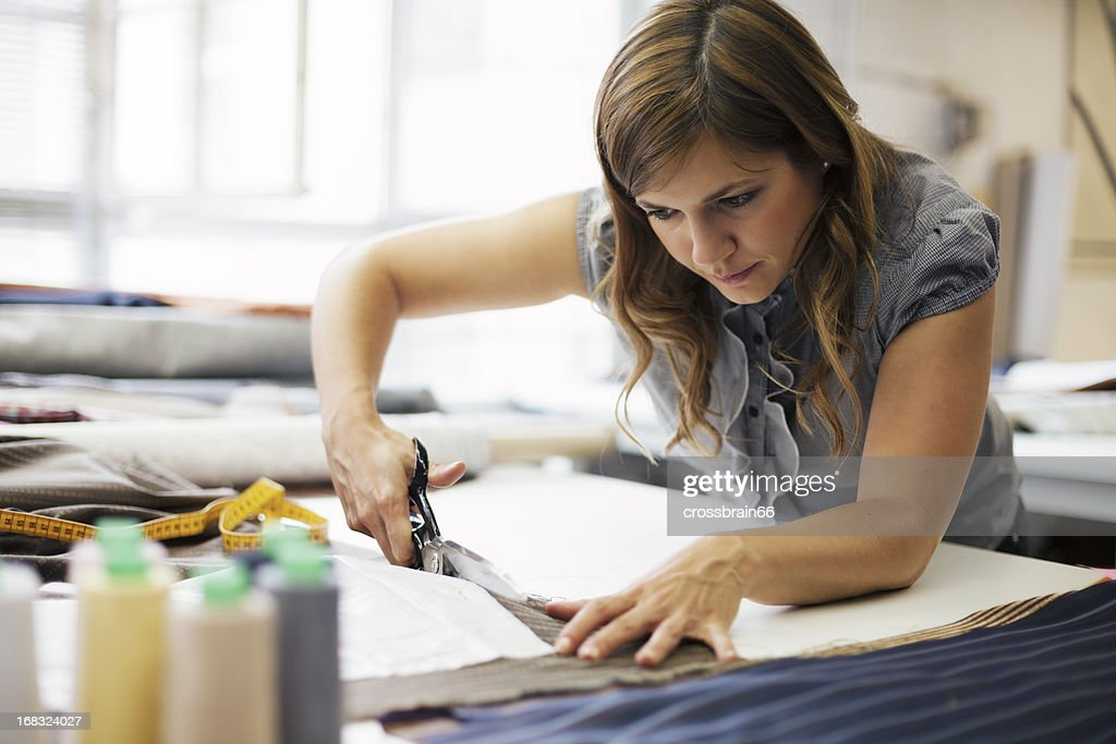 young woman working in clothes manufacture : Stock Photo