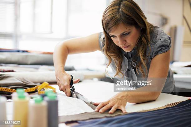young woman working in clothes manufacture - tailor stock photos and pictures