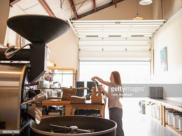 Young woman working in coffee roasting business