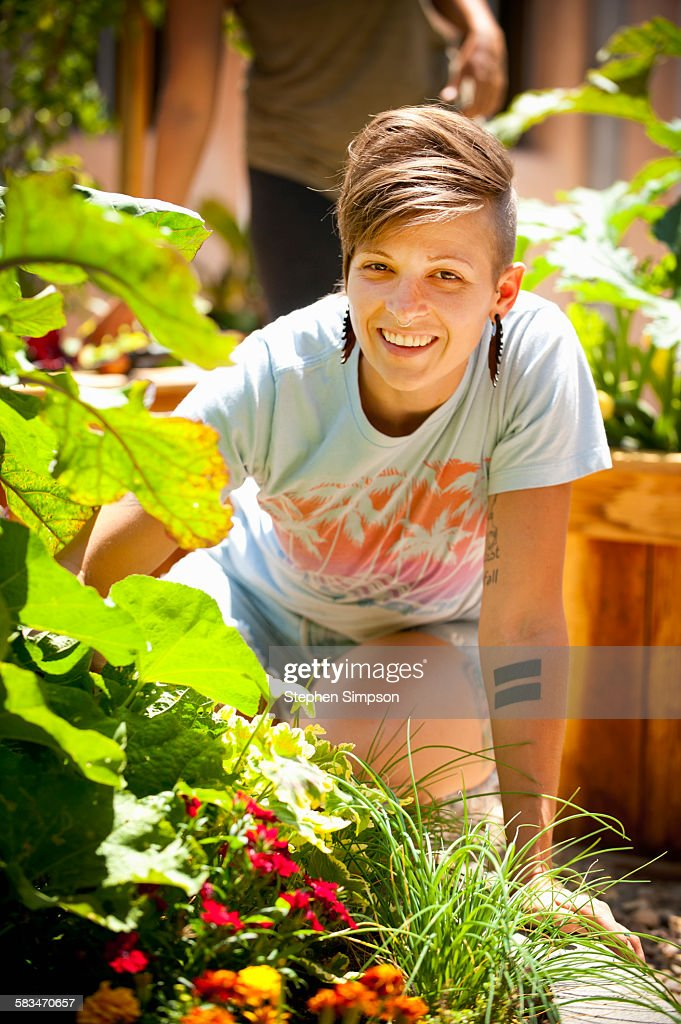 young woman working in community garden : Stock Photo