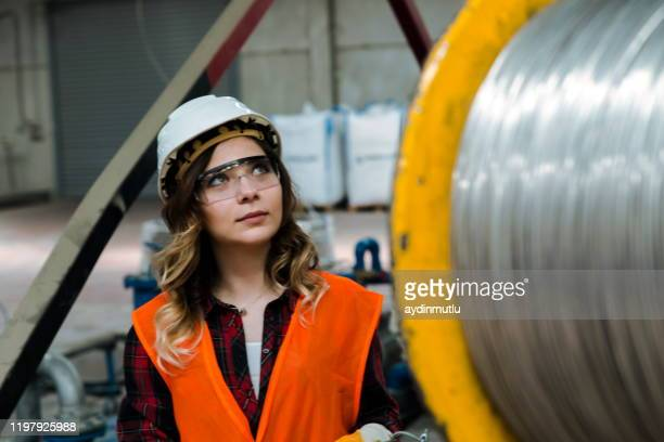 young woman working in factor - hoisting stock pictures, royalty-free photos & images