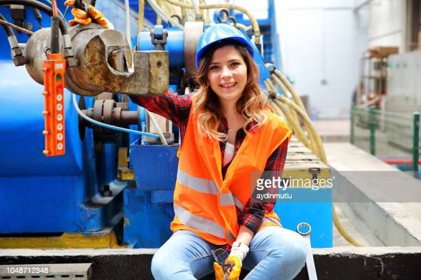 young woman working in factory - mechanical engineering stock pictures, royalty-free photos & images
