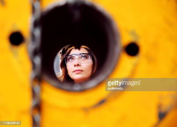 young woman working in factory - metal industry stock pictures, royalty-free photos & images